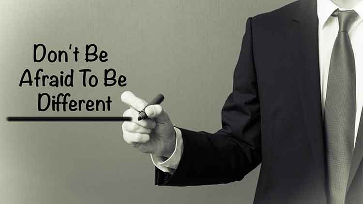 Business man writing - Don't Be Afraid To Be Different
