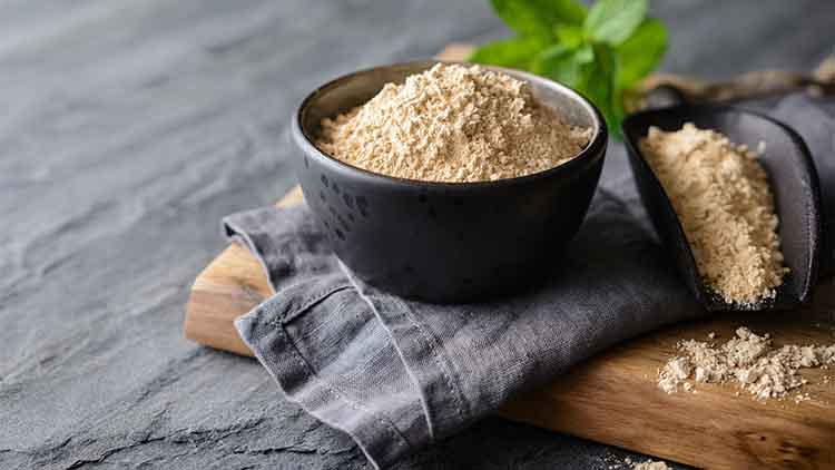 Dietary supplement, Maca root powder in a bowl and scoop