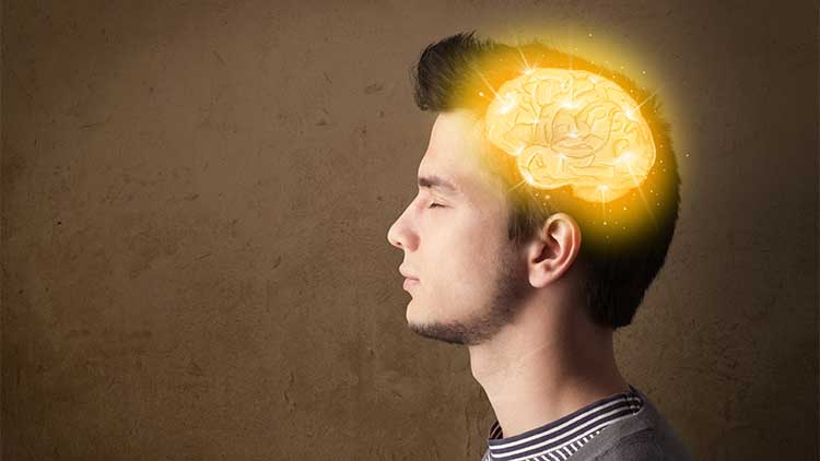 Young man thinking with glowing brain