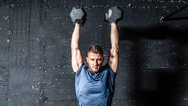 Young strong fit muscular sweaty man with big muscles strength