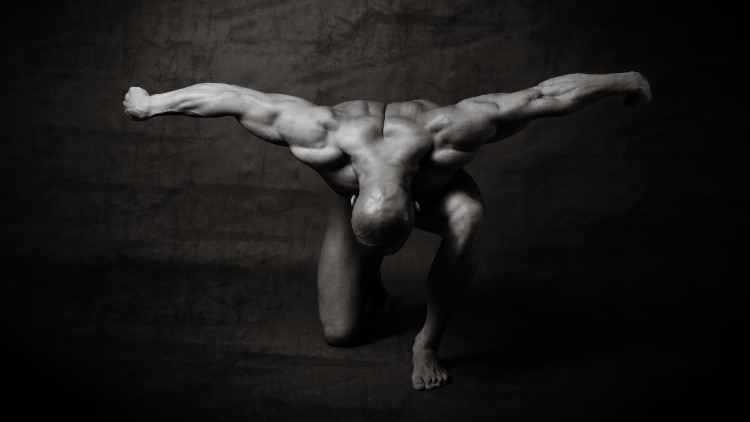 Body builder on one knee bowing