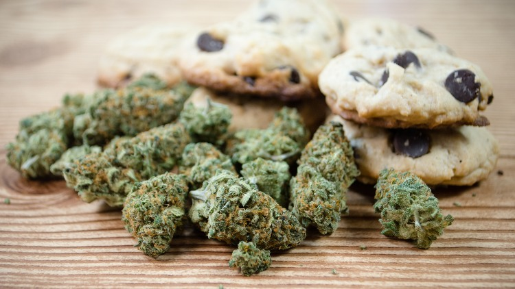Cookies and weed on wooden surface