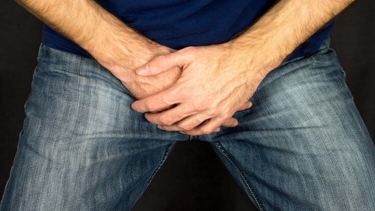 A man protecting his groin with both hands