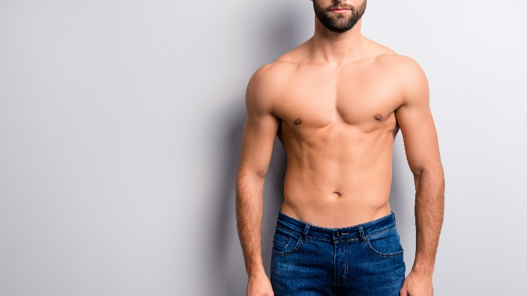 Male model stood in jeans on grey background