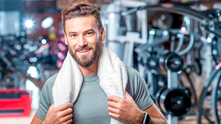 man-with-towel-in-gym