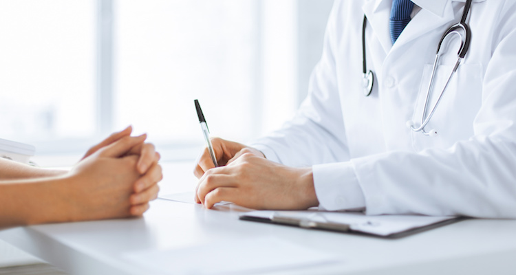 doctor-making-notes-about-patient