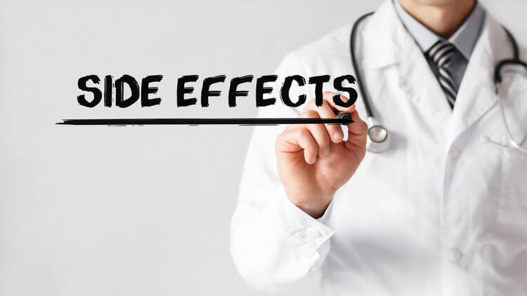 Doctor writing the words side effects with a black marker pen