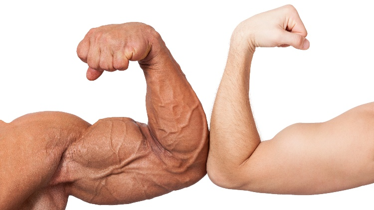 Two arms comparing bicep sizes on white background