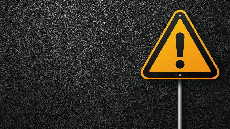 Warning sign on black background